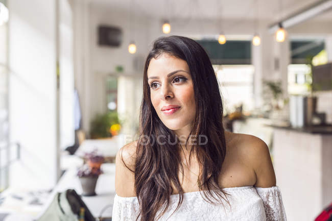 Portrait of young woman in cafe — Stock Photo