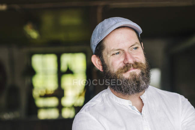 Portrait of bearded man wearing cap — Stock Photo
