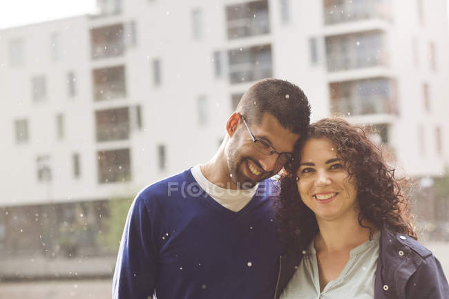 Portrait of mid adult couple standing in rain — Stock Photo