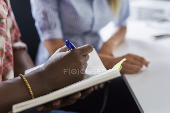 Cropped image of Man writing in notepad — Stock Photo