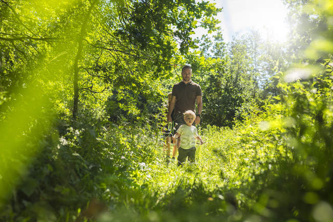 Father and son (2-3) in forest during daytime — Stock Photo