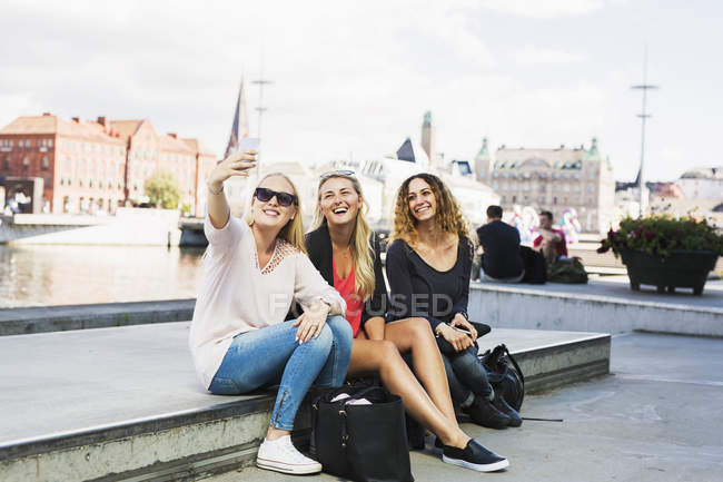 Three young women taking selfie — Stock Photo