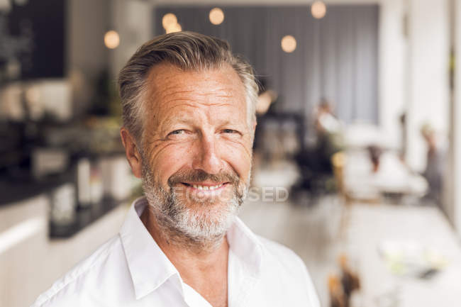 Portrait of senior man in cafe — Stock Photo