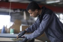 Young african man working with glass — Stock Photo