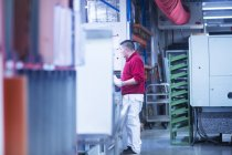 Young man working at plant — Stock Photo