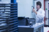 Woman in lab at workplace — Stock Photo