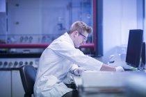 Scientist working at modern laboratory — Stock Photo