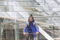 Man riding by bicycle outdoors — Stock Photo