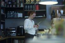 Redhead girl bartender at work — Stock Photo