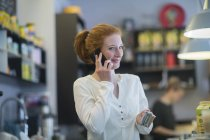 Bartender talking on phone — Stock Photo