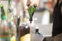 Male bartender doing cocktail — Stock Photo