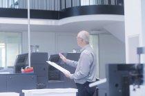 Man working at printing house — Stock Photo