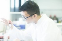 Young asian male pharmacist — Stock Photo