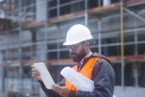 Side view of civil engineer working with digital tablet — Stock Photo