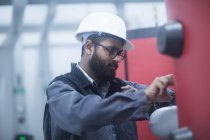 Engineer examining equipment at heating station — Stock Photo