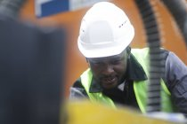Construction worker in hard hat working on building site — Stock Photo