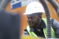 Portrait of construction worker in hard hat on building site — Stock Photo