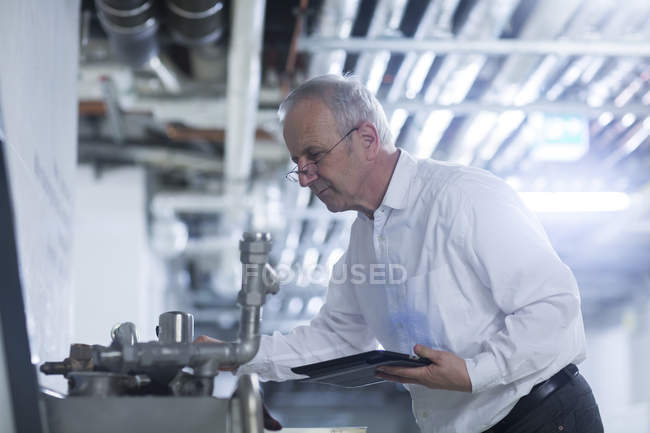 Engineer at production plant — Stock Photo