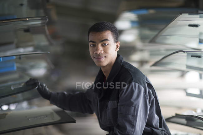 Young african man choosing windshield — Stock Photo