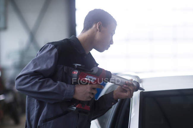 Young african man working on car — Stock Photo