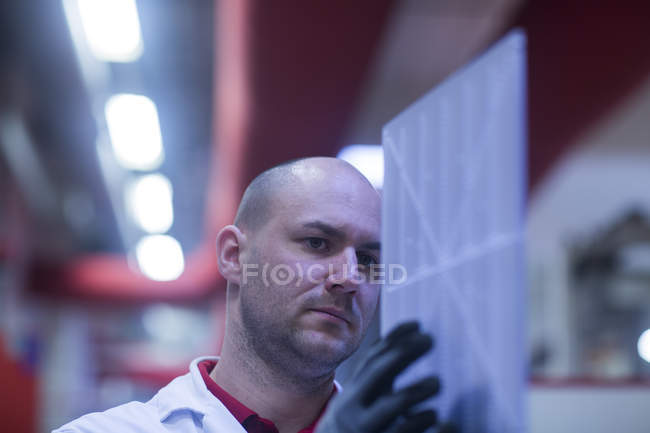 Man checking conductor board — Stock Photo