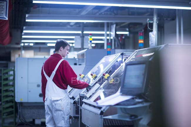 Man working at industrial plant — Stock Photo