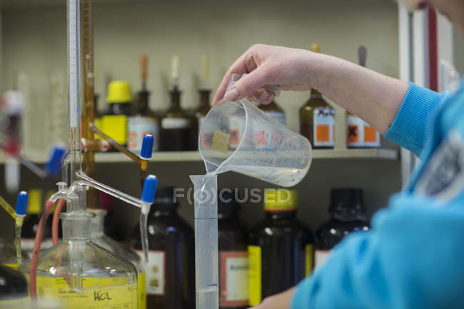 Woman working with substances in laboratory — Stock Photo