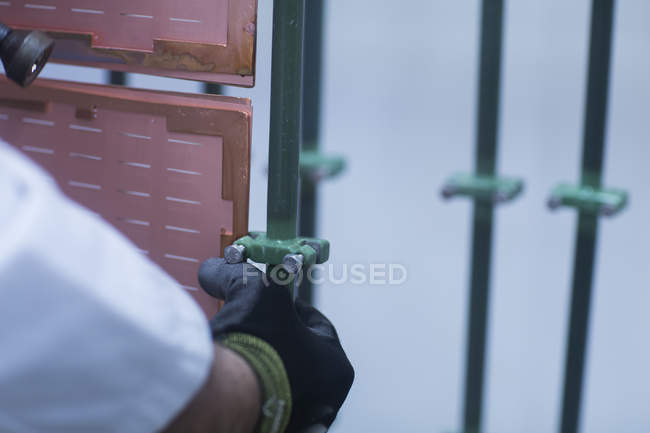 Worker adjusting equipment — Stock Photo
