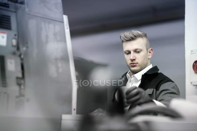 Man adjusting printing machine — Stock Photo