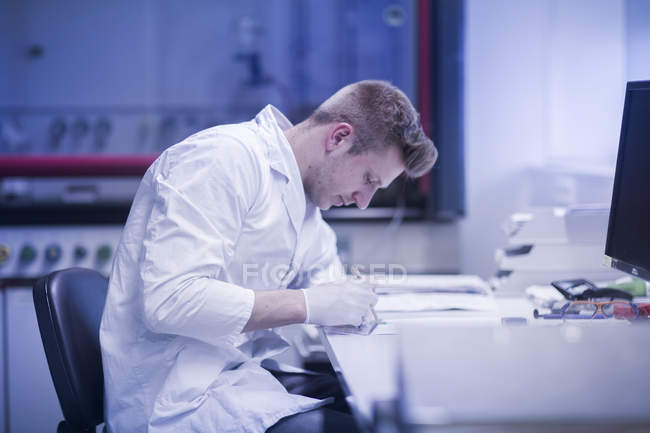 Scientist working at modern laboratory — Stock Photo