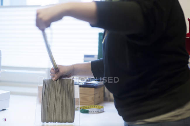 Woman taylor working with materials — Stock Photo