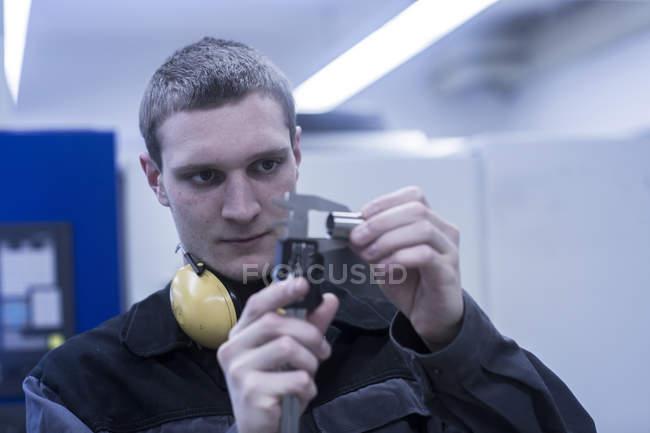 Engineer inspecting working tools — Stock Photo