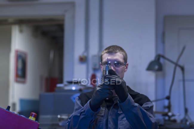Engineer inspecting working tools — Stock Photo