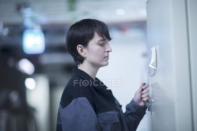 Engineer working at industrial plant — Stock Photo