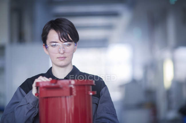 Female engineer working at industrial plant — Stock Photo