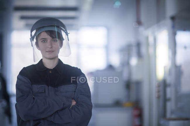 Female engineer in protective helmet — Stock Photo