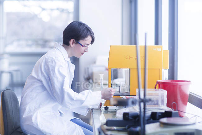 Scientist making scrutiny of sample in laboratory — Stock Photo
