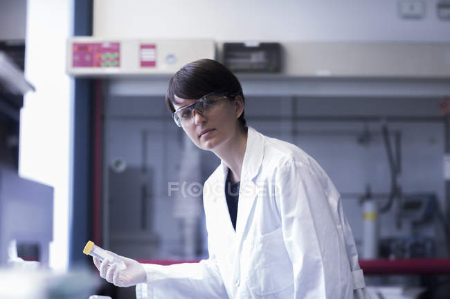 Female scientist holding test tube — Stock Photo