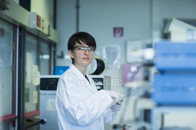 Scientist using digital tablet — Stock Photo