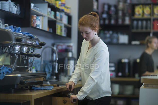 Redhead girl bartender at work — Stock Photo