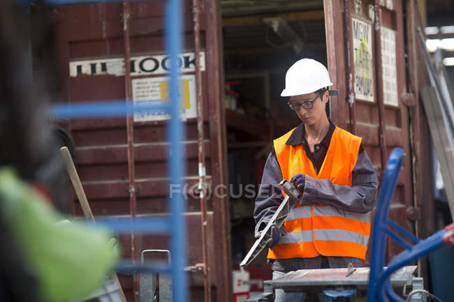 Female working near container at warehouse — Stock Photo