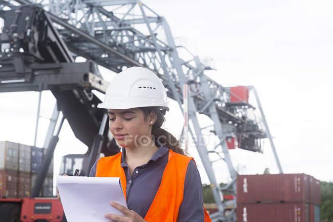 Industrial worker inspecting port area — Stock Photo