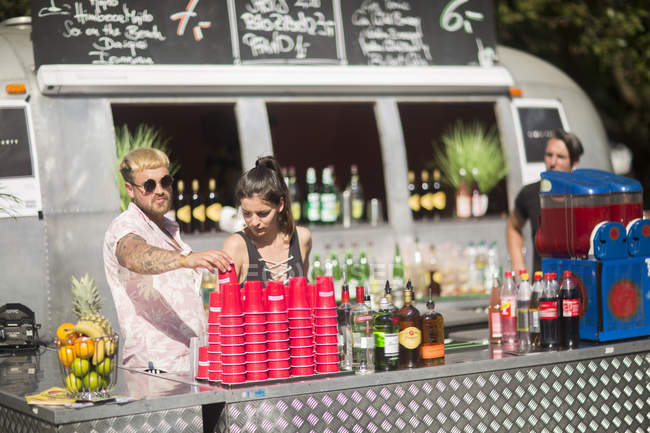 Bartenders near street cocktail van — Stock Photo