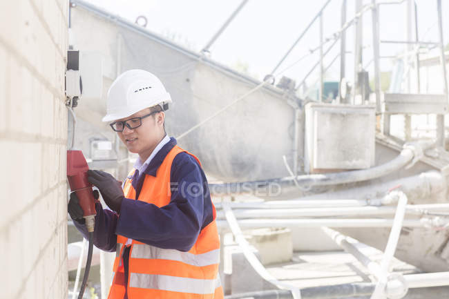 Worker at concrete factory — Stock Photo