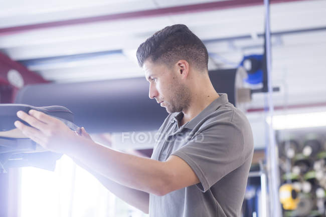 Automobile upholstery workshop with craftsman — Stock Photo