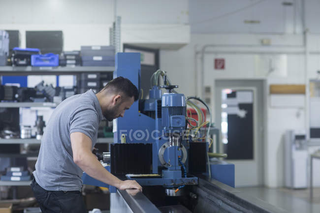 Male worker at grinding shop — Stock Photo