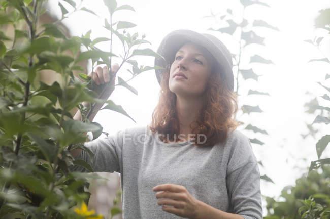 Young redhead woman gardener — Stock Photo