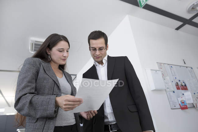 Business people standing with documents — Stock Photo