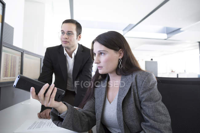 Businessman and businesswoman at office — Stock Photo