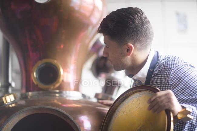 Man working in distillery — Stock Photo